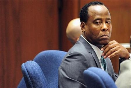 Dr. Conrad Murray sits in court during his trial in the death of pop star Michael Jackson, in Los Angeles October 13, 2011.  REUTERS/Robyn Beck/Pool