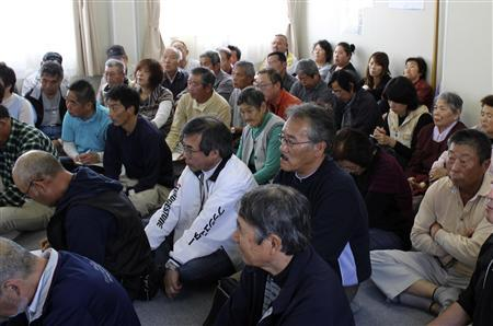 Evacuees who fled from Namie town near the tsunami-crippled Fukushima Daiichi nuclear power plant listen to government officials' explanations about how to apply for compensation at their temporary housing complex in Fukushima  October 6, 2011. At last, victims of Japan's nuclear crisis can claim compensation. And they are angry. They are furious at the red tape they have to wade through just to receive basic help and in despair they still cannot get on with their lives seven months after the huge quake and tsunami triggered the world's worst nuclear disaster in 25 years. Picture was taken on October 6, 2011. REUTERS/Kubota Yoko