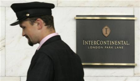 A porter passes a sign for the InterContinental Hotel, Park Lane in London August 11, 2008. REUTERS/Luke MacGregor
