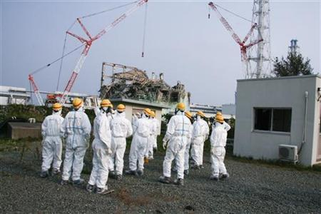Members of the International Atomic Energy Agency (IAEA) International Remediation Expert Mission to Japan examine No.3 reactor at the tsunami-crippled Fukushima Daiichi Nuclear Power Plant in Fukushima prefecture October 11, 2011. Picture taken October 11, 2011.  REUTERS/IAEA/Handout