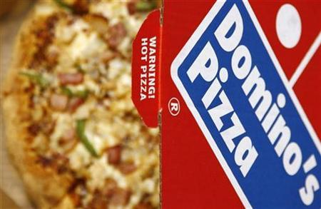 A Domino's Pizza is pictured in its box in central London, February 15, 2009.  REUTERS/Luke MacGregor
