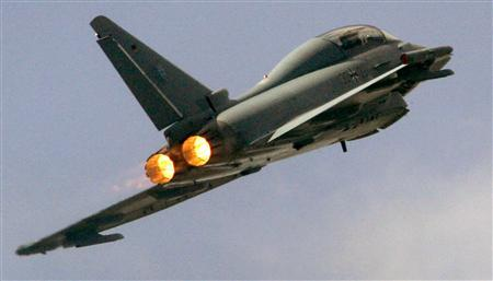 A German Air Force Eurofighter jet flies over an air base near the town of Laage, south of the Baltic harbour city of Rostock, in this file photo taken August 19, 2006.  REUTERS/Arnd Wiegmann/Files