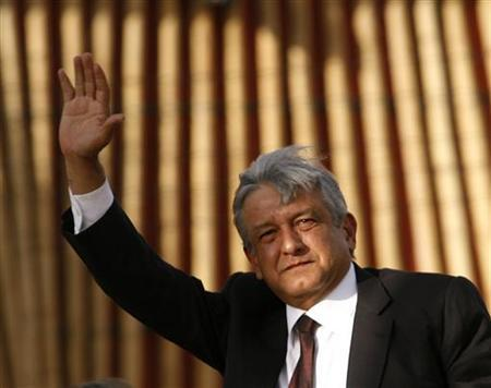 Former presidential candidate Andres Manuel Lopez Obrador waves to supporters as he arrives a meeting and Mexico celebrate the 70th anniversary of the expropriation of Mexico's oil industry at Mexico City's Zocalo March 18, 2008. REUTERS/Henry Romero
