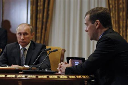 Russia's President Dmitry Medvedev (R) and Prime Minister Vladimir Putin attend a session of the Security Council at the Gorki presidential residence outside Moscow October 14, 2011. REUTERS/Dmitry Astakhov/RIA Novosti/Kremlin