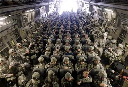 U.S. servicemen sit inside a C-17 Globemaster waiting to take off for Afghanistan at Manas Air Base near Kyrgyzstan's capital Bishkek, February 13, 2009.   REUTERS/Shamil Zhumatov