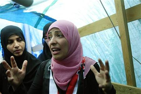 Yemeni Tawakul Karman, one of the three recepients of the 2011 Nobel Peace Prize award talks with reporters at her tent at Tagheer square in Sanaa October 8, 2011.  REUTERS/Khaled Abdullah