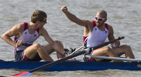 Michael Gennaro (R) of the U.S. raises his fist after he and team mate Robert Otto won the gold medal in the Men's Coxless Pairs rowing competition at the Pan American Games in Ciudad Guzman October 18, 2011. REUTERS/Andy Clark