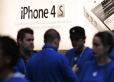 A sign for the iPhone 4S is seen at an Apple Store in New York, October 14, 2011. REUTERS/Brendan McDermid