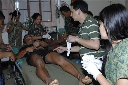 A handout from Western Mindanao Command shows wounded soldiers receiving medical attention at a military hospital in Zamboanga City, southern Philippines October 18, 2011.  REUTERS/Handout