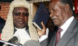 Zambian opposition leader Michael Sata (R) is sworn in as President at the supreme court in the capital Lusaka September 23, 2011.  REUTERS/Makson Wasamunu