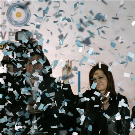 Argentine President Cristina Fernandez de Kirchner greets supporters during a meeting for the 60th anniversary of the first television broadcast in the country at the former ESMA Navy School of Mechanics, in Buenos Aires October 17, 2011. REUTERS/Martin Acosta