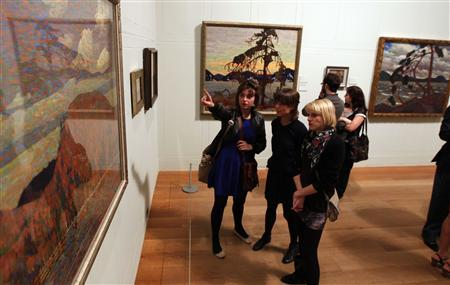 Guests view paintings by Canadian artist Tom Thomson during the a show's opening at the Dulwich Picture Gallery in London October 17, 2011. The gallery is hosting Painting Canada: Tom Thomson and the Group of Seven from October 19, 2011 to January 8, 2012.REUTERS/Chris Helgren