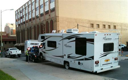 Bexar County Sheriff's department is towing away a recreation vehicle (RV) that was parked in front of Bexar County Courthouse in downtown San Antonio,Texas early morning on October 19, 2011.  REUTERS/Michael Board