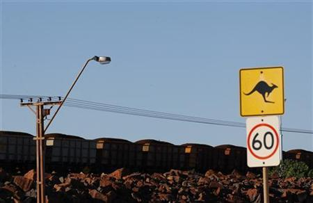 A train loaded with iron ore travels towards the Rio Tinto Parker Point iron ore facility in Dampier at the Pilbarra region in western Australia April 20, 2011. REUTERS/Daniel Munoz