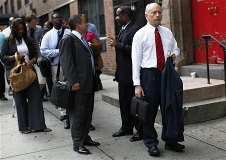 A man waits in line with others to enter a job fair in New York August 15, 2011.  REUTERS/Shannon Stapleton