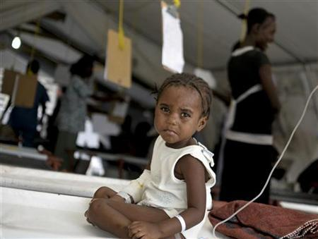 A child stricken with cholera is being treated at a cholera treatment center in Carrefour, an area just outside of Port-au-Prince June 6, 2011. REUTERS/Swoan Parker