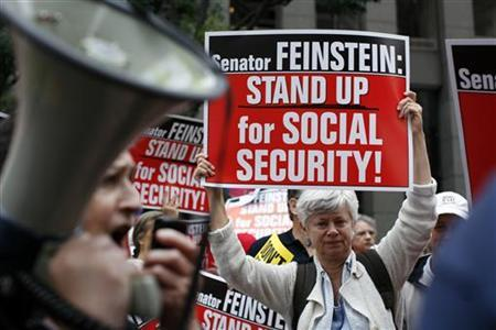 Demonstrators with the California Alliance for Retired Americans hold a rally outside the office of U.S. Senator Dianne Feinstein (D-CA) in San Francisco, California August 17, 2011.  REUTERS/Robert Galbraith