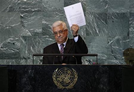 Palestine's President Mahmoud Abbas holds up a copy of the letter that he had just delivered to United Nations Secretary General Ban Ki-moon requesting full United Nations representation for a Palestinian state, during his address before the 66th United Nations General Assembly at U.N. headquarters in New York, September 23, 2011. REUTERS/Mike Segar
