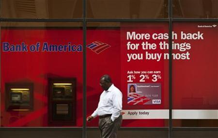 A pedestrian walks past a Bank of America banking branch in Charlotte, North Carolina October 13, 2011.  REUTERS/Chris Keane