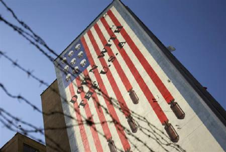 EDITORS' NOTE: Reuters and other foreign media are subject to Iranian restrictions on leaving the office to report, film or take pictures in Tehran.An anti-U.S. mural is seen on a wall of a government building in central Tehran October 12, 2011. REUTERS/Morteza Nikoubazl