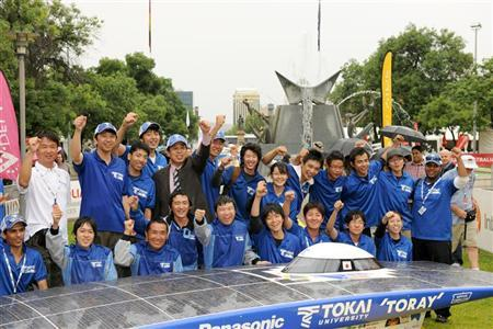 Members of team Tokai from Japan celebrate after crossing the finish line of the World Solar Challenge race in Adelaide October 20, 2011. REUTERS/World Solar Challenge/Handout