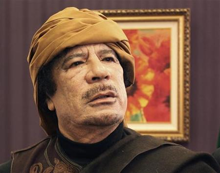 Libya's leader Muammar Gaddafi poses after an interview with TRT Turkish television reporter Mehmet Akif Ersoy at the Rixos hotel in Tripoli March 8, 2011. Picture taken March 8, 2011. REUTERS/Huseyin Dogan