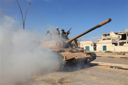 Anti-Gaddafi fighters celebrated the fall of Sirte  October 20, 2011.  REUTERS/Esam Al-Fetori