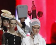 <p>Models present creations at the final of the Russian Silhouette youth fashion contest in Moscow, October 18, 2011. REUTERS/Sergei Karpukhin</p>