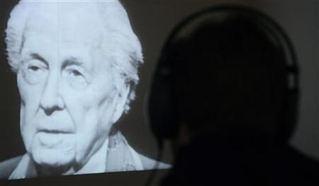A visitor watches an archive television interview with U.S. architect Frank Lloyd Wright at the Guggenheim museum in Bilbao October 21, 2009. REUTERS/Vincent West