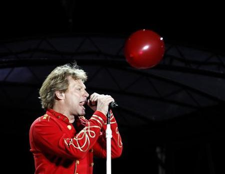 Musician Jon Bon Jovi performs at Olympic stadium ''Lluis Companys'' during the concert, part of the band's European ''Open Air Tour'', in Barcelona July 27, 2011.     REUTERS/Gustau Nacarino