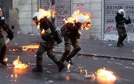 Policemen are set ablaze on fire by a petrol bomb thrown by protesters during clashes near the Parliament building in Syntagma square in Athens, October 20, 2011.  REUTERS/ Yannis Behrakis
