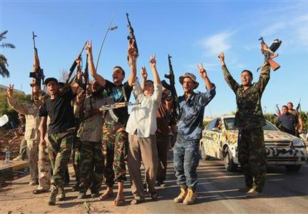 Anti-Gaddafi fighters celebrate the fall of Gaddafi in Sirte October 20, 2011.    REUTERS/Esam Al-Fetori