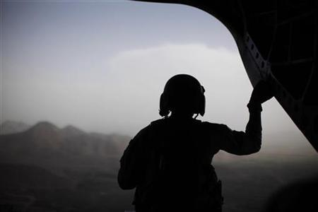 A U.S. Army crewman sits at the rear of a CH-47 Chinook helicopter accompanying the Blackhawk of U.S. Secretary of Defense Robert Gates (not pictured) between Forward Operating Bases in over eastern Afghanistan, June 6, 2011.    REUTERS/Jason Reed