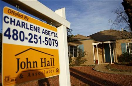 A realtor sign is displayed near a house for sale in Phoenix, Arizona, January 4, 2011.  REUTERS/Joshua Lott