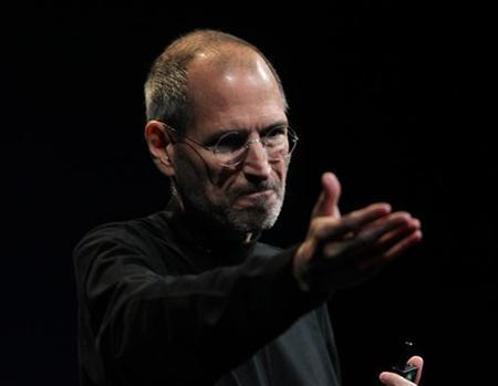 Apple CEO Steve Jobs gestures during his unveiling of the iPhone 4 at the Apple Worldwide Developers Conference in San Francisco, California, in this June 7, 2010 file photo.   REUTERS/Robert Galbraith/Files