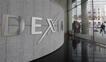 A man walks past Belgian-French financial services group Dexia headquarters in Brussels October 10, 2011.     REUTERS/Yves Herman