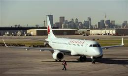 <p>An Air Canada plane gets ready for take off at the International airport in Calgary, September 20, 2011. REUTERS/Todd Korol</p>