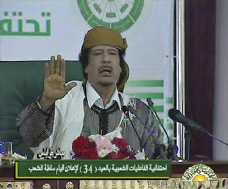 Muammar Gaddafi speaks at an event in Tripoli in this March 2, 2011 image from video. REUTERS/Libyan TV via Reuters TV/Files