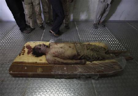 The body of slain Libyan leader Muammar Gaddafi is seen inside a storage freezer in Misrata October 21, 2011. REUTERS/Saad Shalash