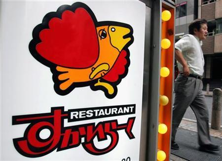 A man walks past a signboard of the Japanese restaurant chain Skylark in Tokyo June 8, 2006. REUTERS/Yuriko Nakao