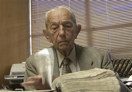 Harold Camping is seen reading the Bible in his office at Family Stations Inc. offices in Oakland, California in this still image from video May 16, 2011. REUTERS/Reuters Television