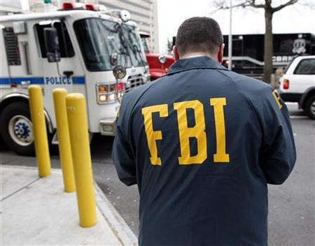 An FBI Special Agent is seen in this file photo in Queens, New York March 25, 2010.       REUTERS/Chip East