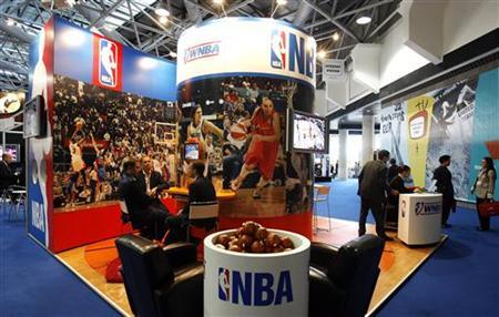 People visit the NBA stand at Sportel 2006 (International Sport Program Market for Television and New Media) in Monte Carlo October 16, 2006. REUTERS/Eric Gaillard