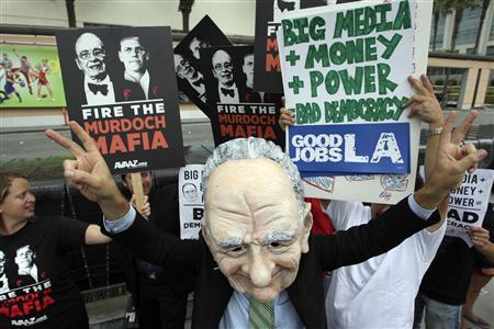 Brent Olson wears a puppet head representation of Rupert Murdoch as protesters demonstrate at Fox Studios during the annual News Corp. stockholder meeting in Los Angeles, California October 21, 2011.  REUTERS/David McNew