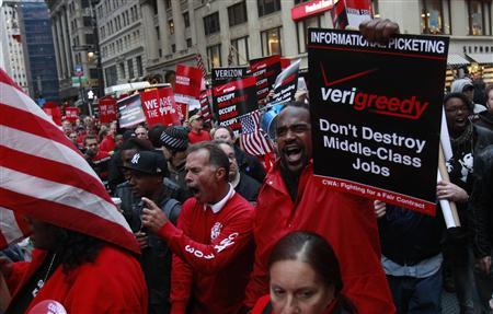 Verizon Communications workers march in past Zuccotti Park in solidarity with the Occupy Wall Street campaign in New York October 21, 2011. REUTERS/Shannon Stapleton