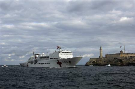 Chinese navy hospital-ship ''Peace Ark'', passes by the lighthouse of the colonial fortress Morro Cabana as it enters Havana Harbour October 21, 2011. REUTERS/Stringer