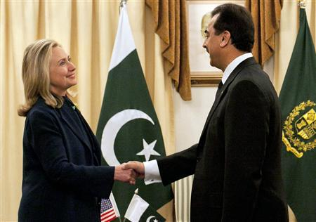Pakistan's Prime Minister Yusuf Raza Gilan greets Secretary of State Hillary Clinton (L) at the prime minister's residence in Islamabad October 20, 2011. REUTERS/Mian Khursheed
