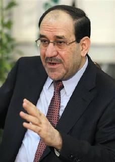 Iraq's Prime Minister Nuri al-Maliki speaks during an interview with Reuters in Baghdad October 9, 2011. REUTERS/Mohammed Ameen/Files