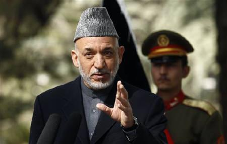 Afghan President Hamid Karzai speaks during a news conference at the Presidential Palace in Kabul October 20, 2011. REUTERS/Kevin Lamarque
