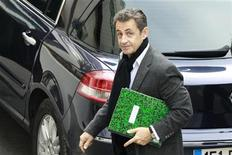 France's President Nicolas Sarkozy arrives for an afternoon visit at the Clinique de la Muette maternity clinic in Paris October 22, 2011.  REUTERS/Gonzalo Fuentes